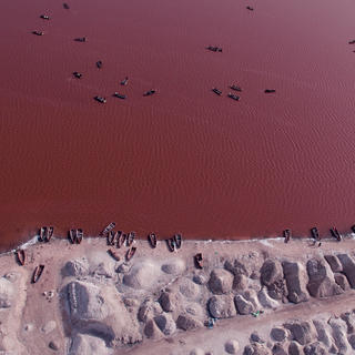 Floating over the pink waters of Lake Retba
