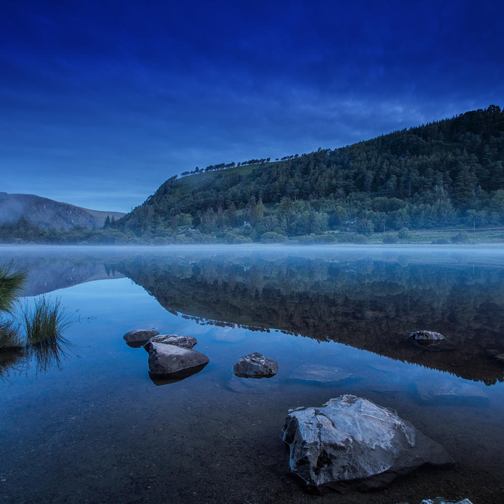 Walk through the ruins of the windy and green hills of Glendalough