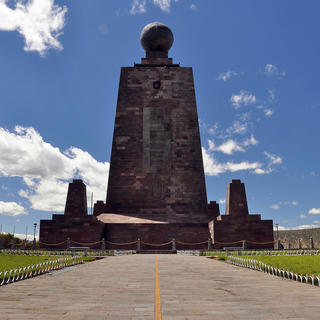 Mitad del Mundo, one foot on each side of the equator