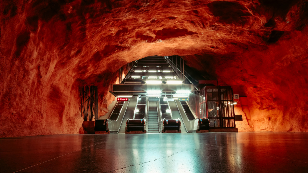 Stockholm (Sweden):  The Rådhuset station plunges users into a reddish cavern-like setting.